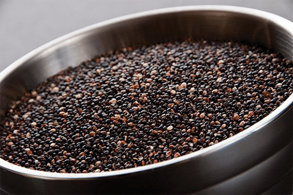 Toasted Black quinoa in bowl overhead