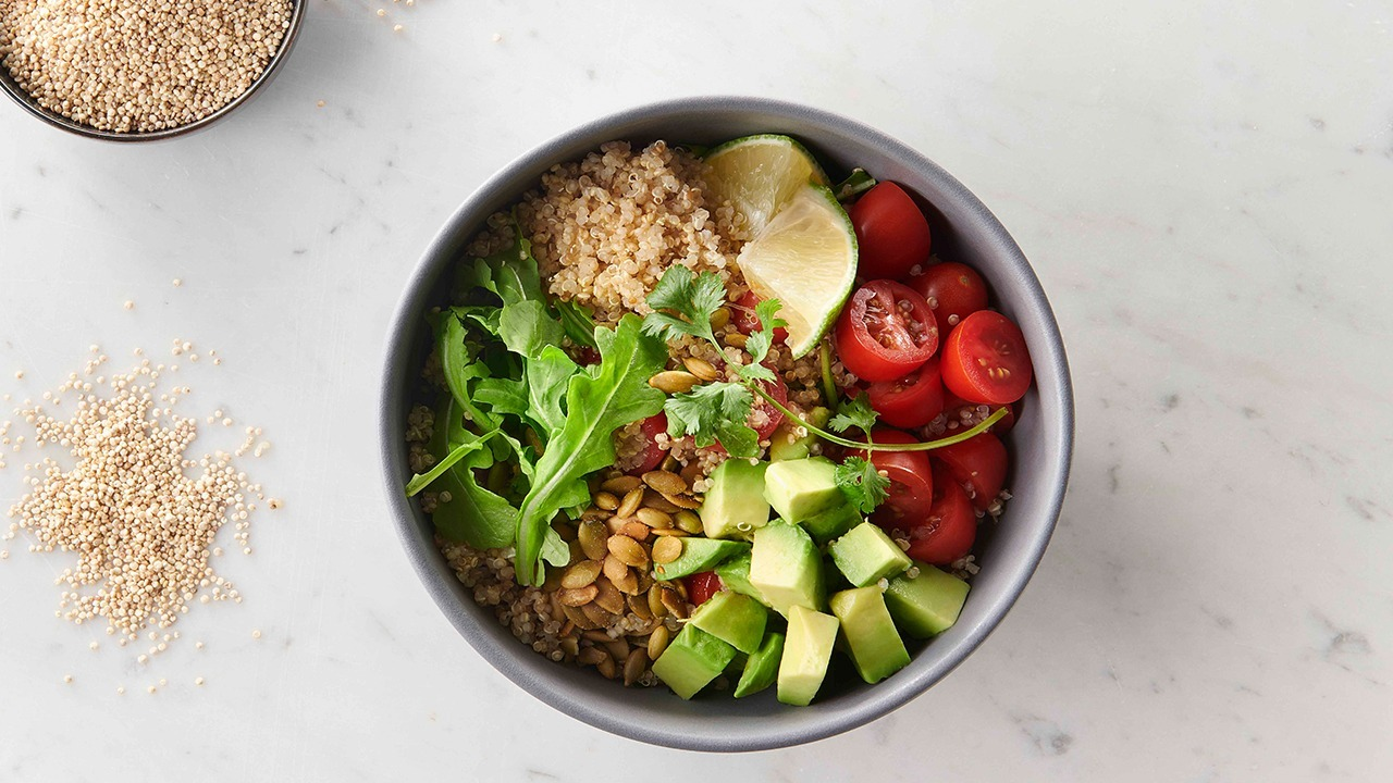 honey lime quinoa salad in bowl on counter